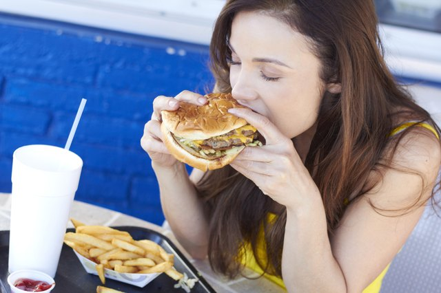 Young Woman Eating a Delicious Burger