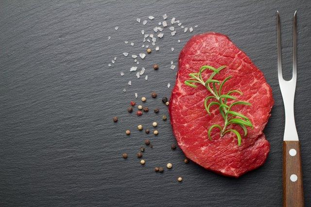 raw steak on slate