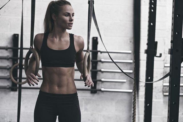 Female athlete training in the gym.