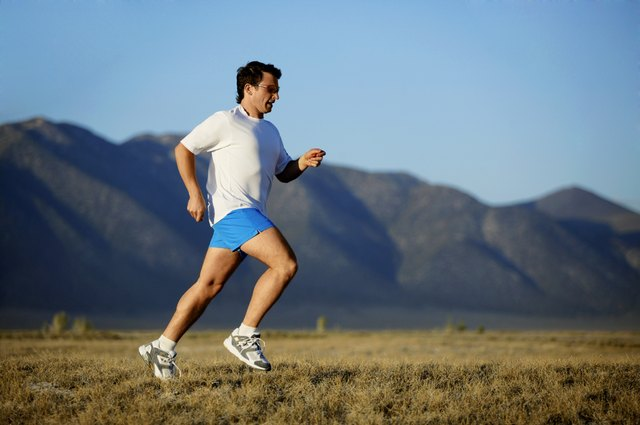 Man running with mountains,  California,  USA