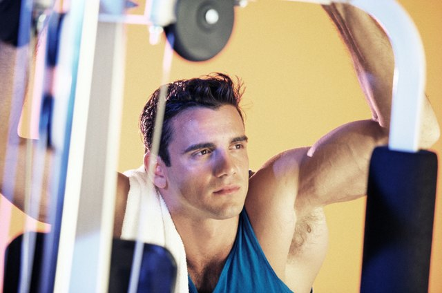 Fit man on exercise equipment