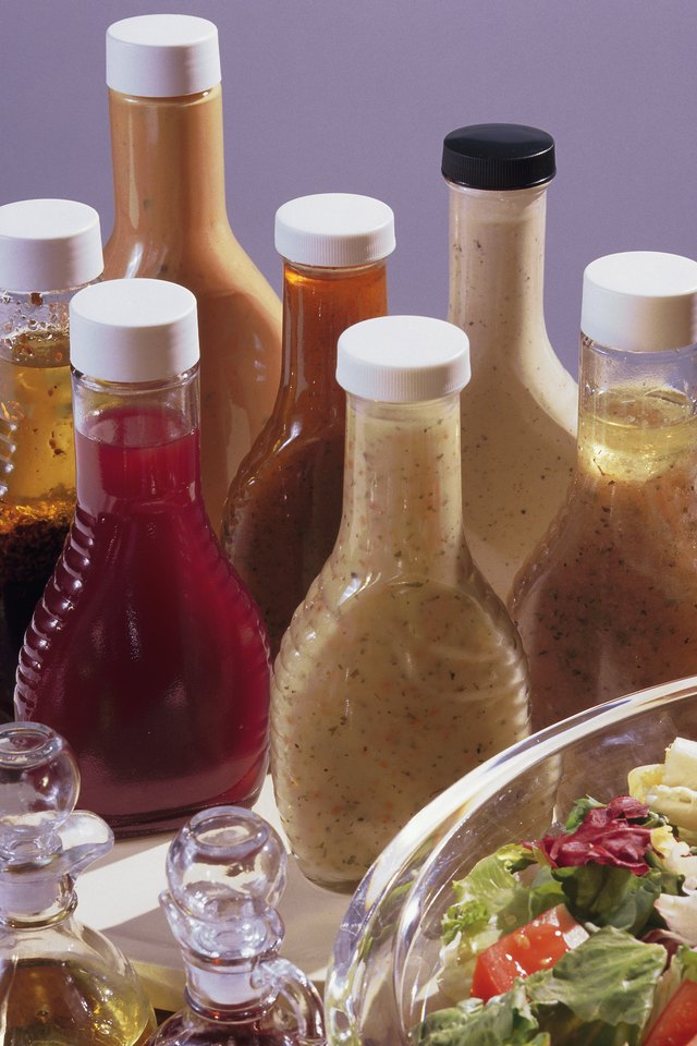 Salad with assorted bottles of dressing