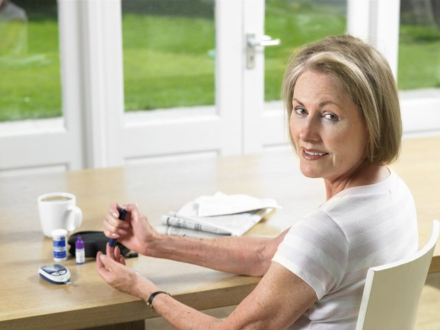 Woman using glucometer for diabetes