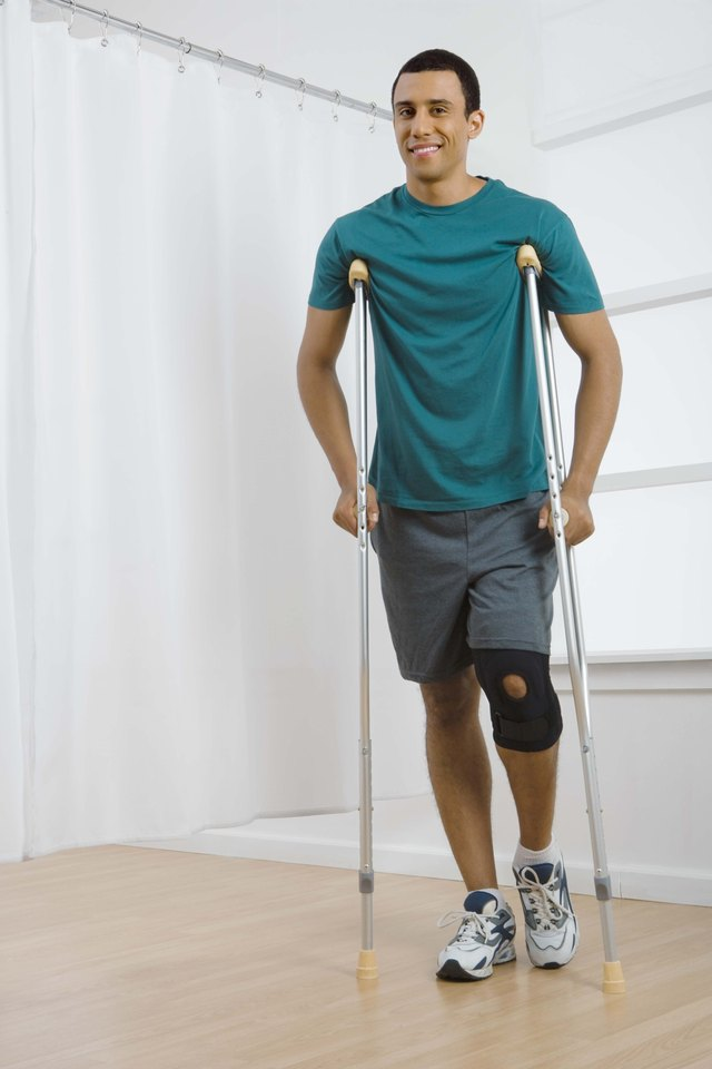 Man with knee brace and crutches