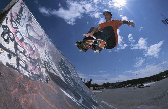 Skateboarding using ramp at skate park