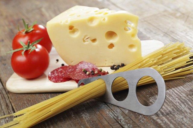 Cheese, salami, and raw spaghetti