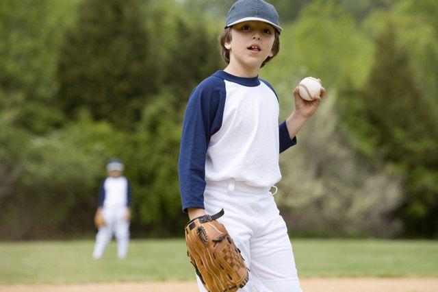 Little leaguer holding ball