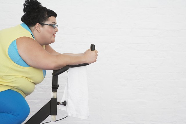 Overweight Woman Riding Exercise Bike