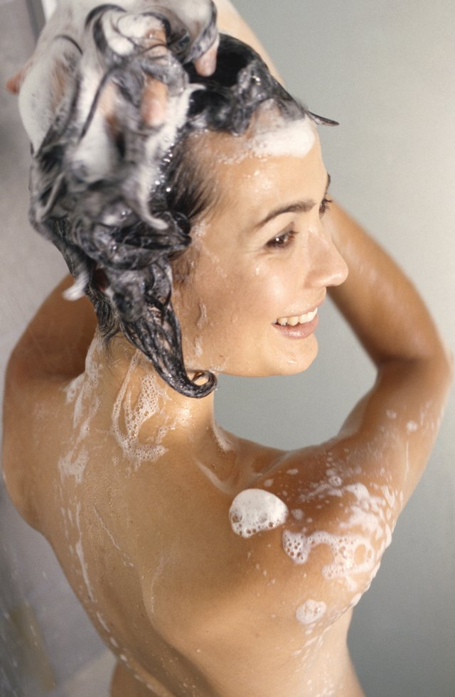 Woman cleaning in shower