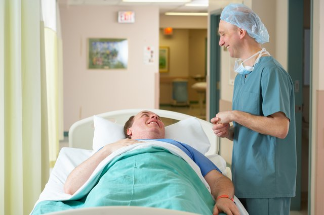 Surgeon talking to patient