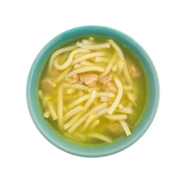 Chicken noodle soup in a green bowl