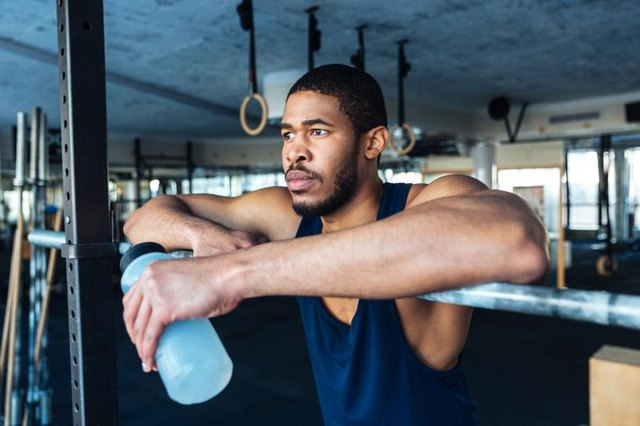 Fitness Man Resting In Healthy Club Gym After Exercising