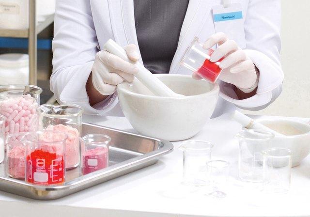 pharmacist preparing medication with mortar