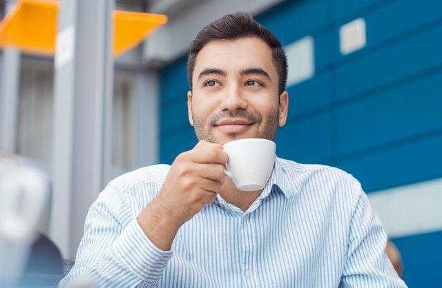 Coffee break, man resting with warmly drink