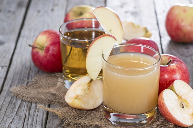Small Glass with fresh Apple Juice