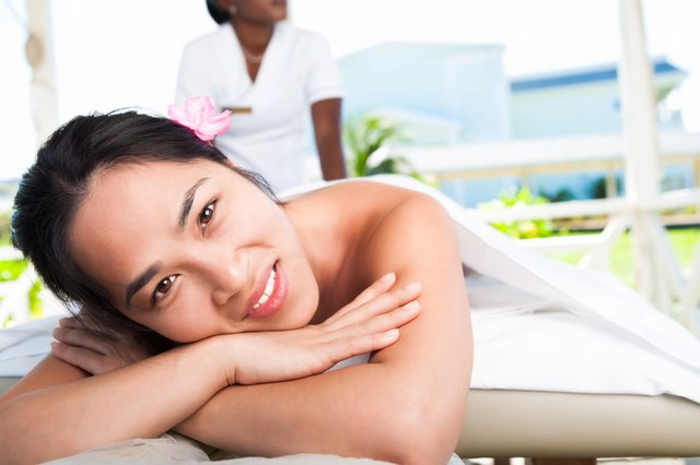 Smiling asian woman at the spa