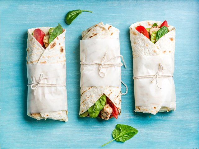 Healthy lunch snack. Tortilla wraps with grilled chicken fillet and