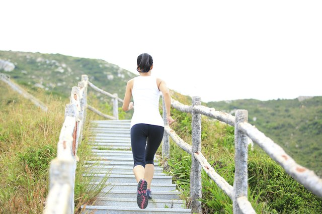 woman runner mountain stairs