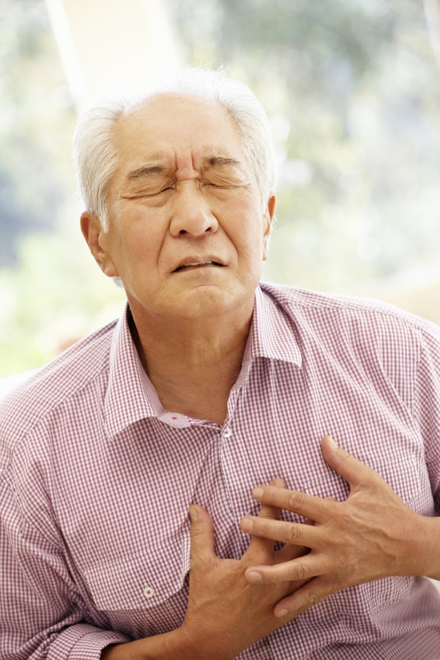 Senior Asian man with chest pain