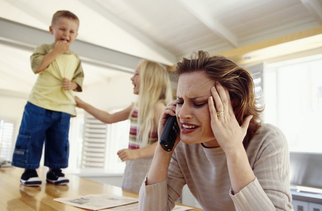 Stressed woman on telephone