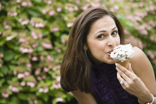Portrait of a woman eating ice-cream cone