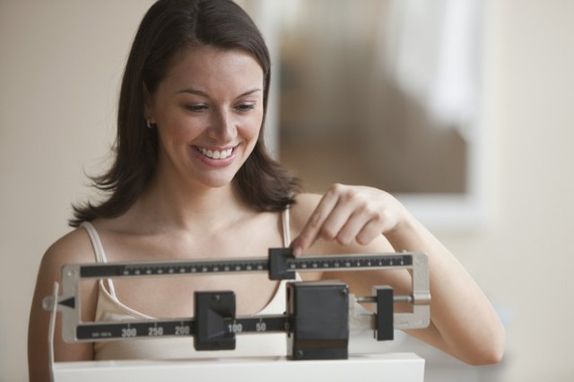 Close up of a woman weighing herself