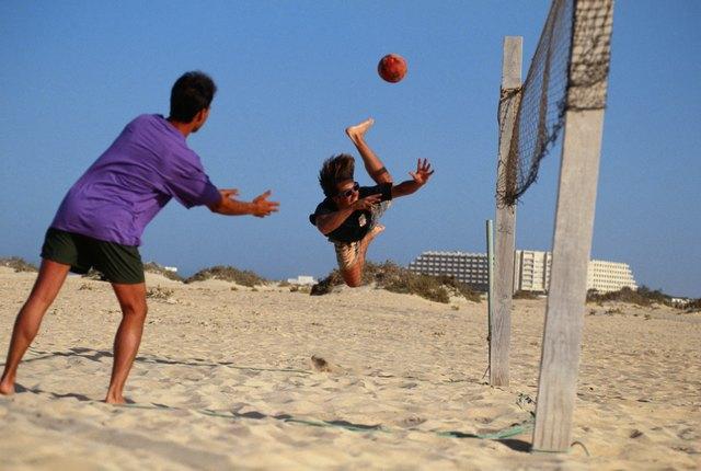 Men playing beach volleyball