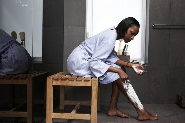 Woman grooming in modern bathroom