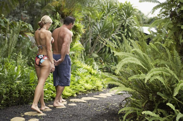 Couple walking on tropical path