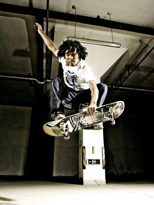 Man performing jump on skateboard