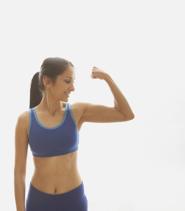 Young woman flexing her muscles