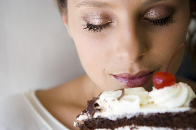 Woman smelling cake