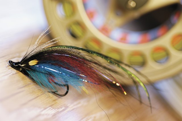 Close-up of a fishing lure and a fishing reel