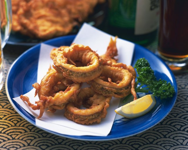 Sliced fried squid on plate, high angle view, differential focus