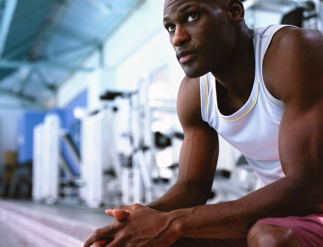 low angle close-up of a man sitting in a gym