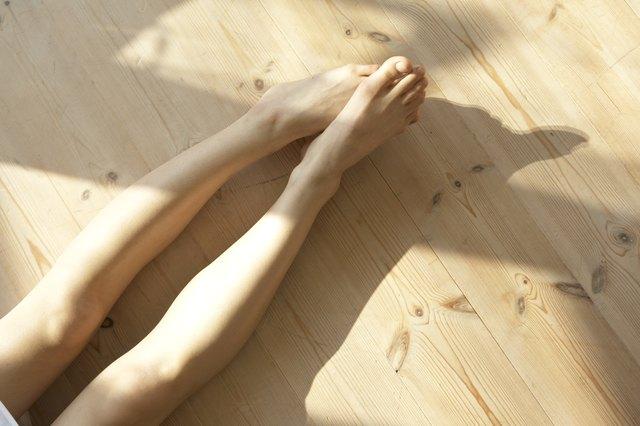 Woman's legs on living room floor