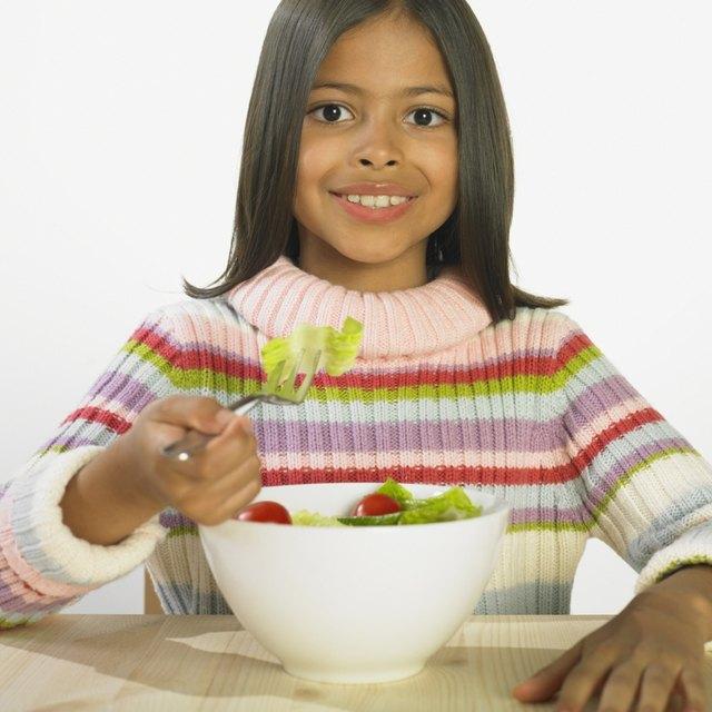 Hispanic girl eating salad
