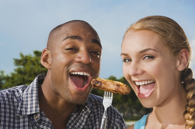 Multi-ethnic couple eating from same fork