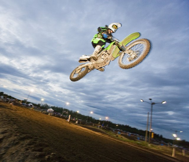 Motorcross rider jumping on track
