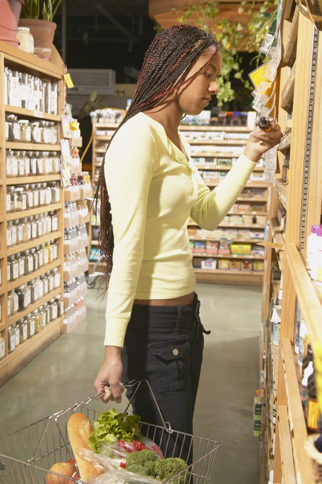 Teenage girl shopping in a supermarket
