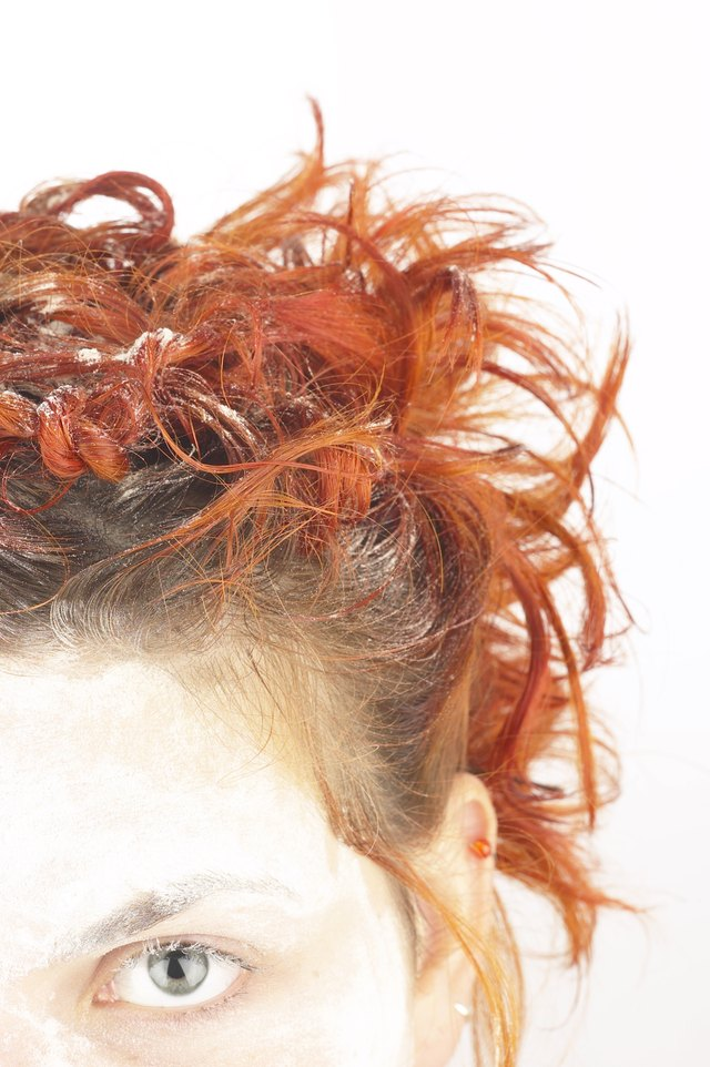 Cropped head shot of girl with curly red hair