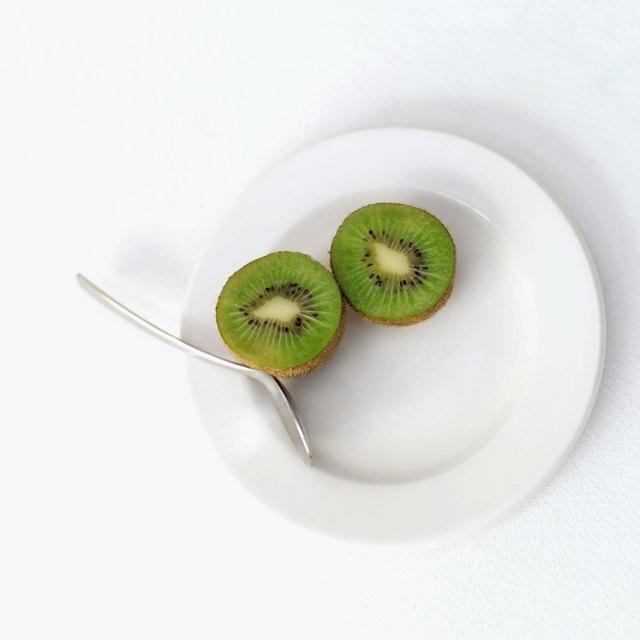 sliced kiwi on a plate with a fork