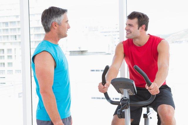 Trainer with man on exercise bike