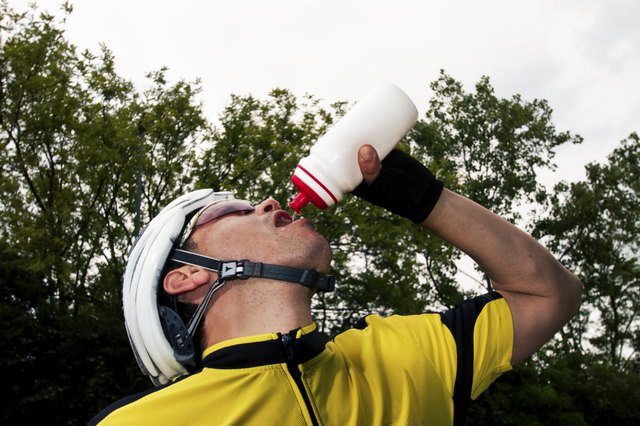 Cyclist drinking an energy drink