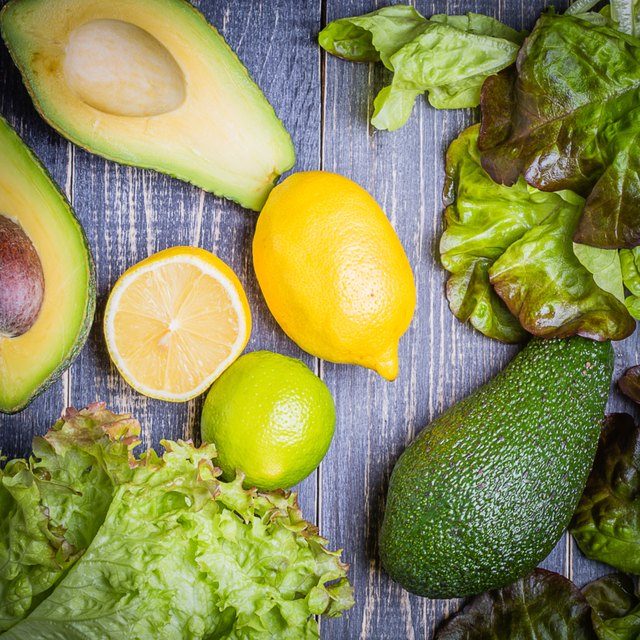 set of salad - lettuce mix, avocado, lemon, lime