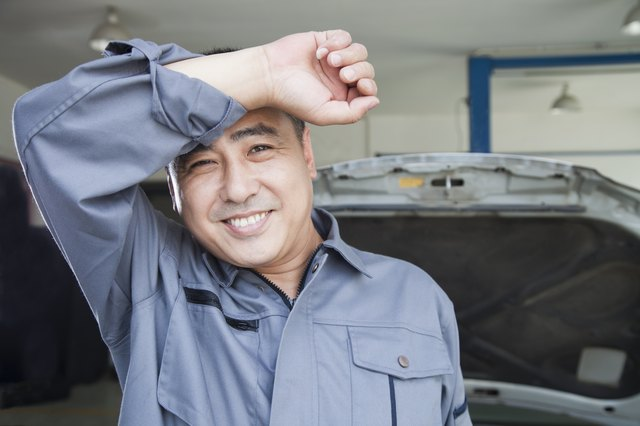 Auto Mechanic Wiping the Sweat Off His Brow