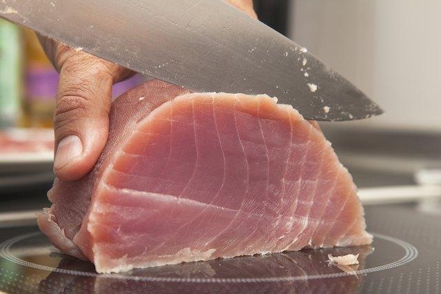 Knife Cutting Tuna Meat