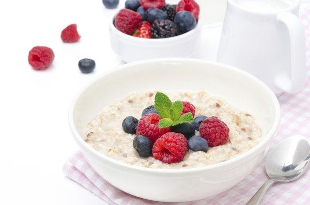 healthy breakfast - oatmeal with fresh berries isolated on white