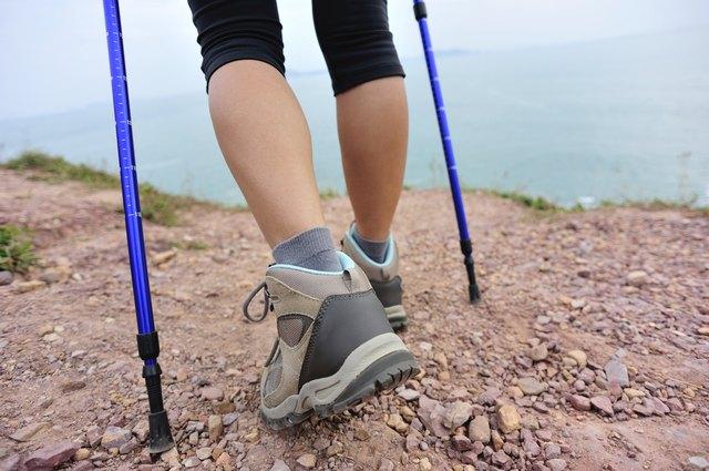 hiking legs on seaside mountain trail