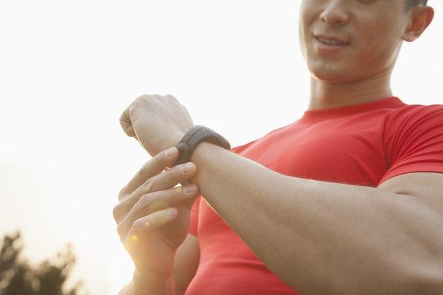 Muscular Man Checking His Watch